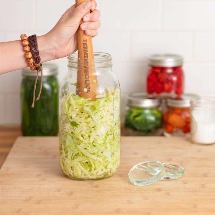 Smashing Cabbage With Wooden Tamper Tool, Making Sauerkraut